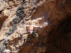 Rock Climbing Photo: The powerful move reaching left on Sinister Dane, ...