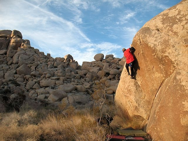 James near the top of Dripper Left (V2), Joshua Tree NP