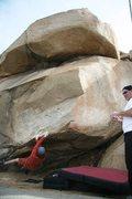 Rock Climbing Photo: Hand traversing the lip on the Beach Problem, V2+