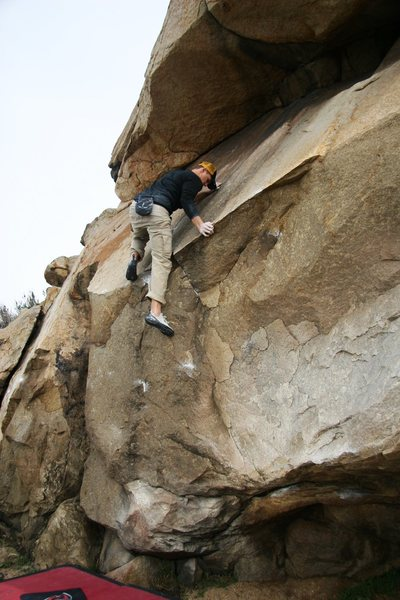 Making the committing high step on Haney Wall, V1