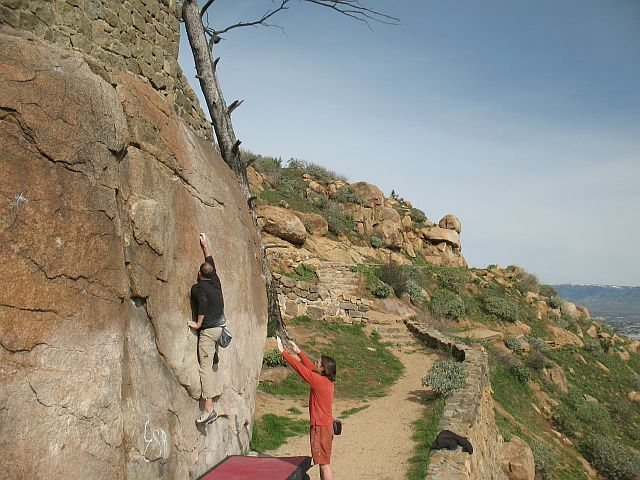 Ryan stretching out on King Bee (V1), Mt. Rubidoux