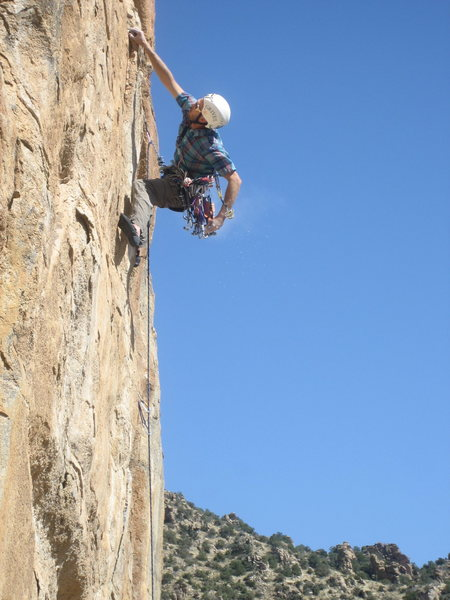Rehearsals lead to fortune for Jesse Schultz as he sends the route. Photo by Aleix Serrat-Capdevila