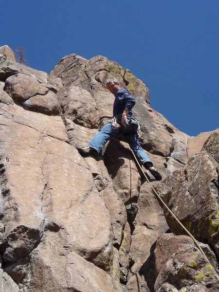 """Short and sweet.  """"Meat is Tasty"""" climbs the crack just right of the climber's head."""