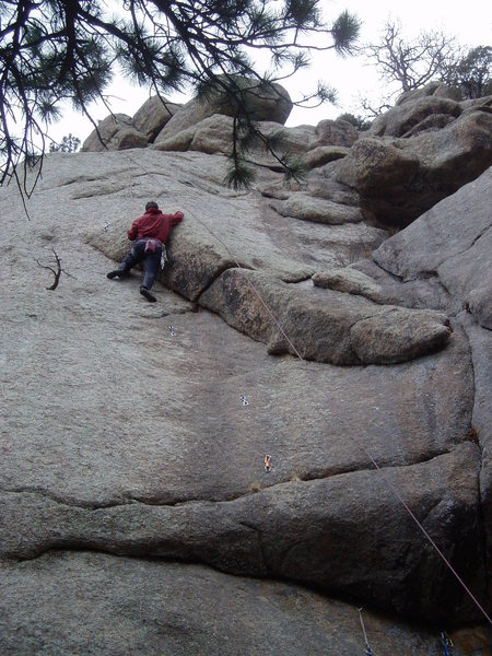Moving right out of the corner using a thin finger flake is another mini crux.