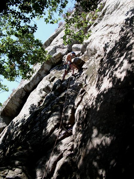 "During a ""bold lead"", Jeff Rininger pauses at the 5.4 crux to contemplate whether the climb is called  ""Dirty Rat's Crack"" or ""Dead Rat's Crack""."