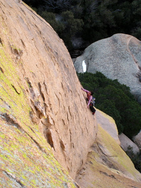 Seconding the pitch and just past the crux of getting out onto the face. The standard crack of P2 of Forest Lawn is the obvious crack/corner to the climber's left.