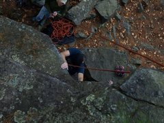 Pulling the roof on Mantrap. Roof edge is a major sloper. Picture made from top of route by JLe.