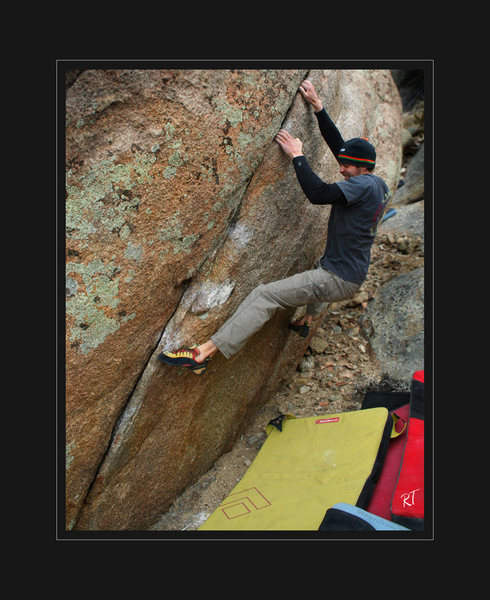 Colby F. marching his fingers into a shallow seam in large 20/25ft boulder.