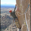 Starting the crux of Stampede! in Cochise Stronghold.  Photo by Manny R.