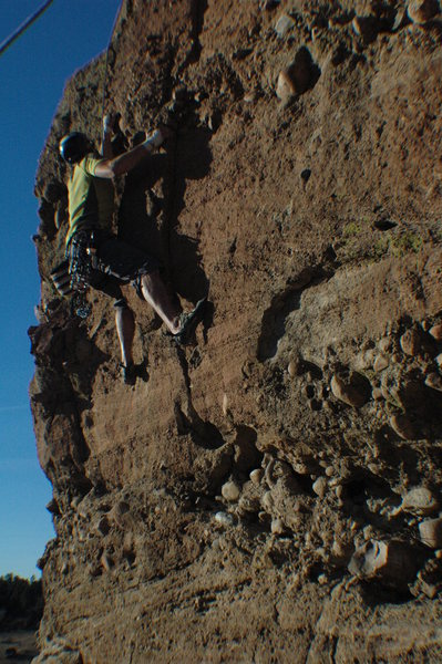 "Climber on the crux of ""Spring and Fall""."