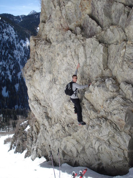 "While hiking up to ski, I stopped to check out some of the routes, using the snow as a boulder pad.  The fifth bolt on this climb is 18"" above my left hand.  The second bolt is at the level of my skiis, the first bolt is buried in the snow somewhere.  I'll have to come back and climb this when the snow melts."