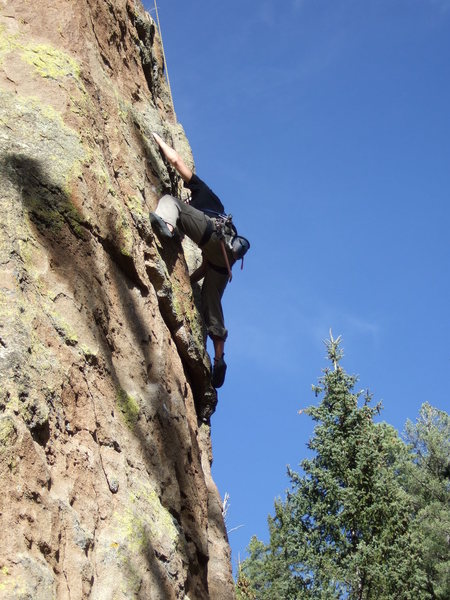 M. Hoffman cruising the crux before the hollow sounding jugs were removed. The original rating on this was 9+, and got harder due to the extensive cleaning that was done.