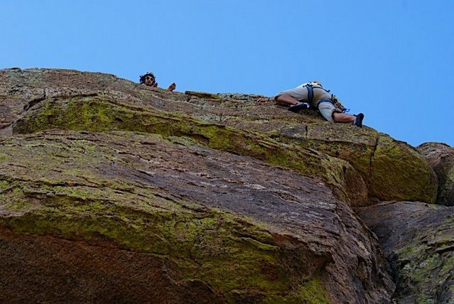 belaying barefoot from the top of the second pitch<br> photo: Daniel Woolfolk