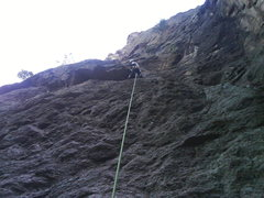 Easy to moderate start, crux is in middle, finish to two bolt anchor next to obvious overhang.