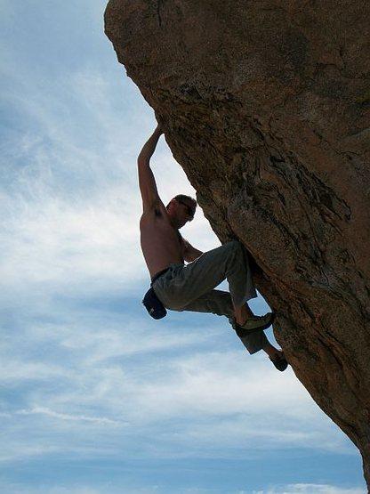 James on the steep prow of Psyche (V4), Joshua Tree NP