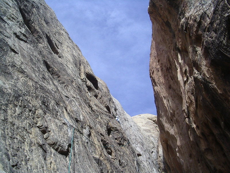 About to lower back into the slot.P2 A direct escape could be made up the difficult looking steep slab above ,but more pro bolts than we carry would be needed.Photo Pat Moe