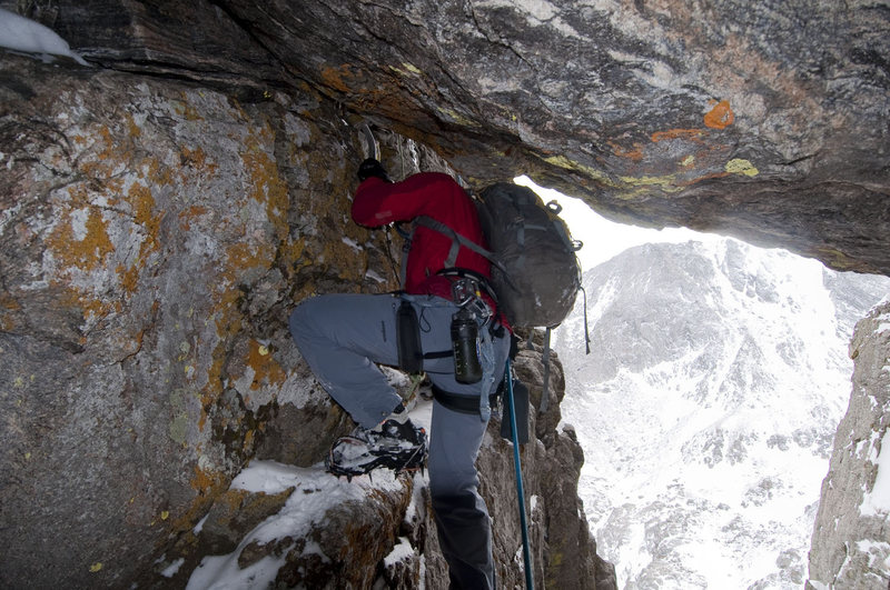 Steve Su exiting the cave at the start of pitch 2 on the first ascent of Dog House.  Photo by Jonny Copp.