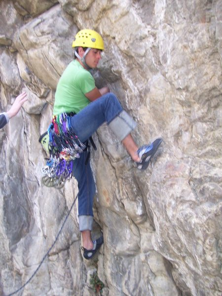 Tristan Higbee showing how to trust your feet on the very slippery crux start.