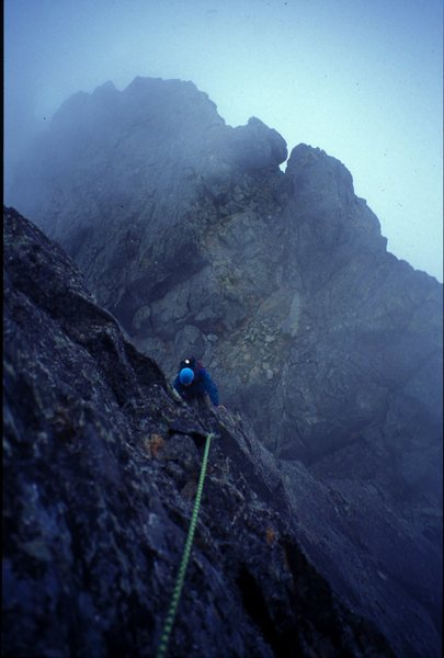 Shane Cook following the crux pitch on the Settler's NW Ridge on the first ascent in some wet weather.