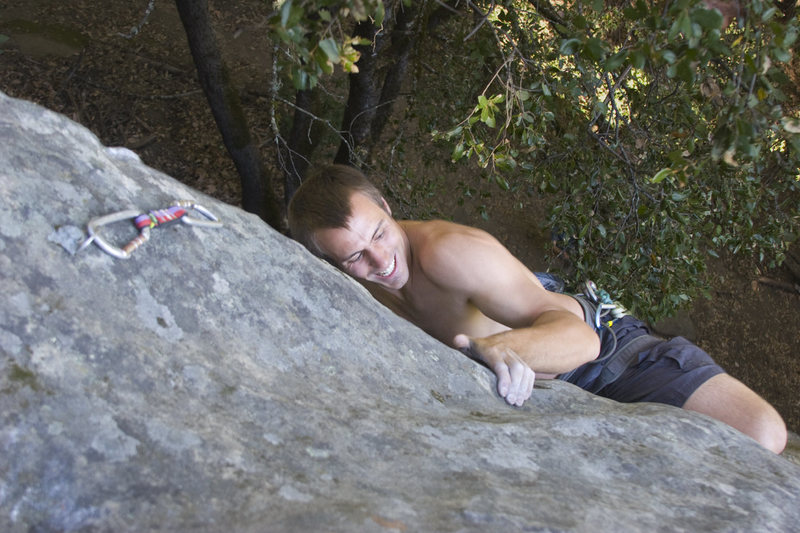 Rock Climbing Photo: Clement pulls over the roof, 5.11a, Castle Rock St...