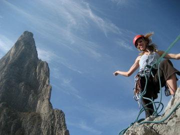 It's a giant rock climbing girl!