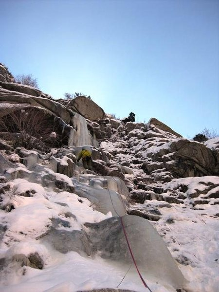 Leading up low angle but thin ice on Genuflect Falls.  Photo by Matt.