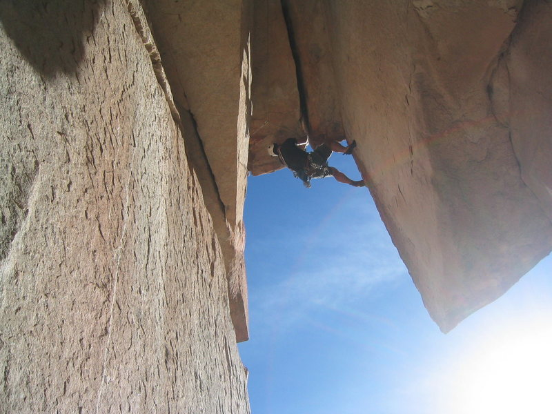 Friend, Eric, pulling through the wide roof.  What a great route - can't wait to lead it next time!