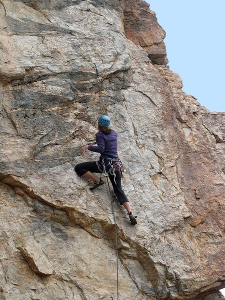 Erica Bigio cranks through the lower crux.