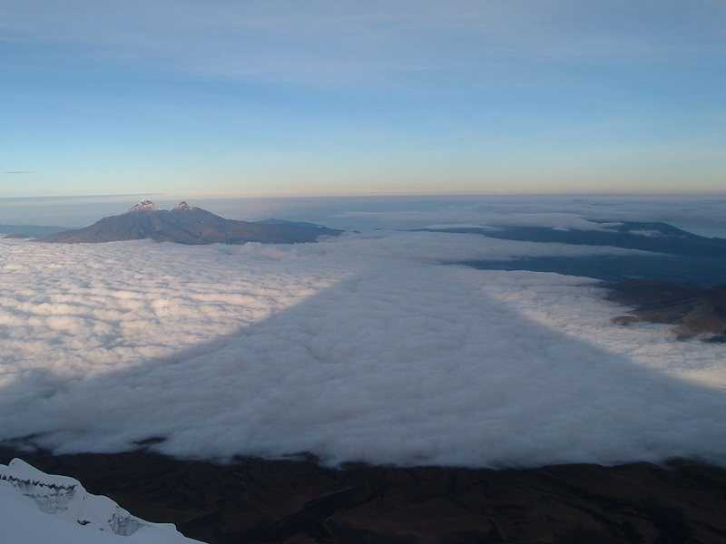 Shadow of Cotopaxi from the regular route, a very enjoyable and scenic snow climb. Illinizas in the distance.