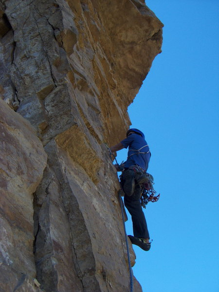 Beginning of the crux pitch on The International, Glenwood Canyon. Chris is shown here climbing the totally hollow and precarious flake below the roof.
