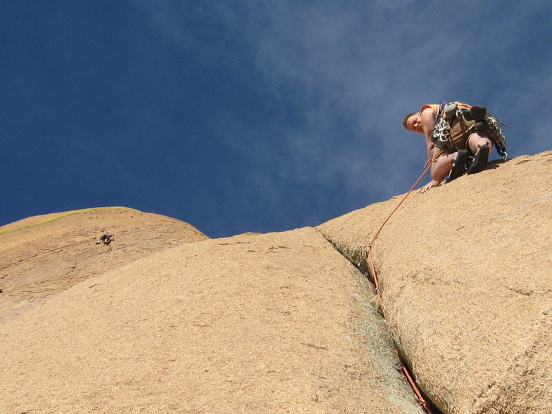 Stu exiting the crux crack on pitch 4 while Jeff leads pitch 5