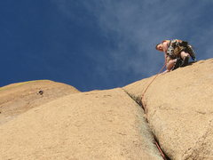 Rock Climbing Photo: Stu exiting the crux crack on pitch 4 while Jeff l...