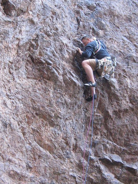 The unprotected, technical crux of the first pitch. The bottoms of my feet are aproximately 20 feet off the ground!