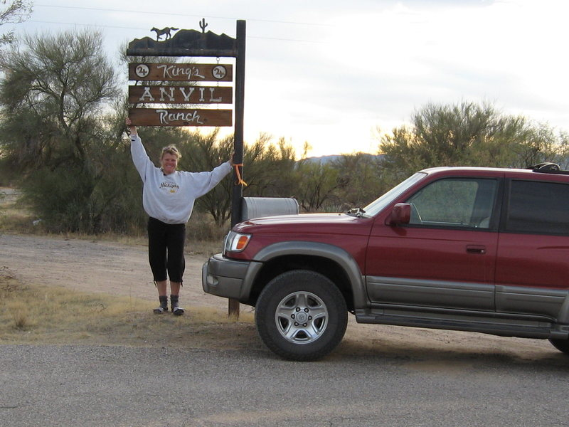 Kimberly points out the sign at the turnoff to King's Anvil Ranch