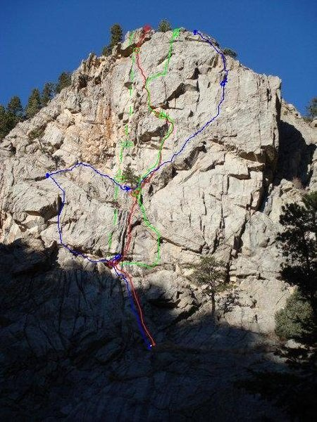 The Blue line is my first attempt to climb left side. It was an adventure. The gear was sparse.<br> <br> The red line was my second attempt. It was a little closer I think.<br> <br> Green line is the third climb. We rapped in from the top, since the boulder falls approach was closed. Then the black groove was wet so I traversed right before moving up along some sport route. The third pitch was run out and pulled over a 9+/10- roof.<br> <br> You can go wherever the hell you want on that third pitch!