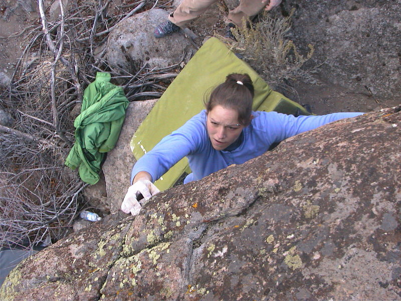 Cat sticking the crux throw and preparing for the tricky mantle to the top.