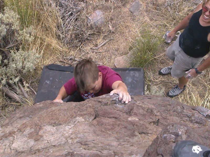 Rock Climbing Photo: Cedar sticking the crux throw on spiderman.