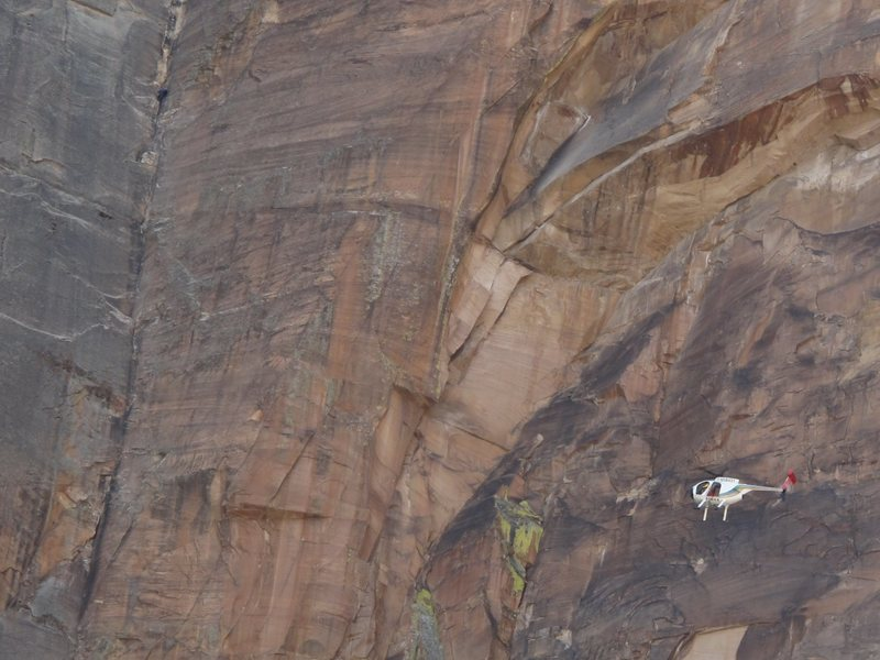 Rock Climbing Photo: A police helicopter buzzes a climber on Rainbow Wa...