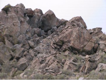 The scenic boulders: The large boulder to the right is Boulder A, The overhanging boulder just above it and to left is Boulder B, and the boulder just to the left of that one is Boulder C.