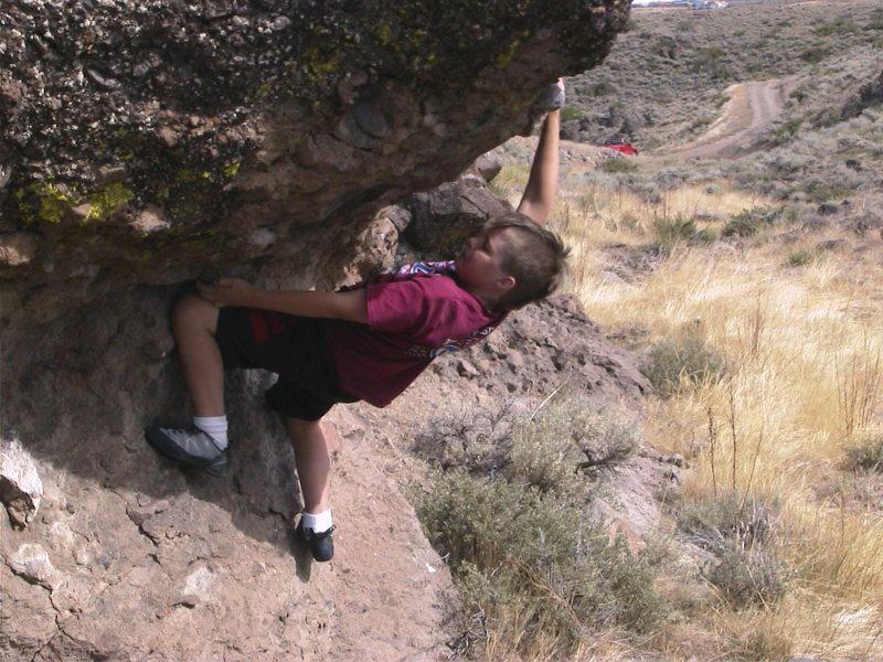 Rock Climbing Photo: Cedar entering the crux of the rough roof.