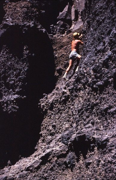 The final bit, pebbly low class climbing on a very warm day (1978)<br> <br> Mike Dean climbing