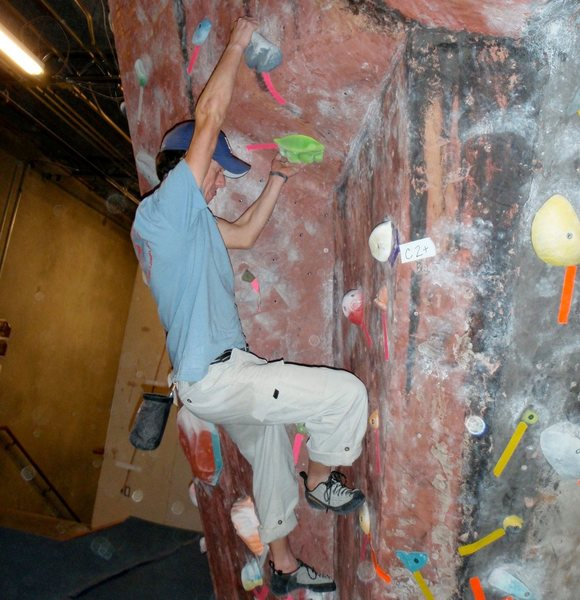 Bouldering at ClimbMax gym. And yes, sticking my tongue out does help me send.