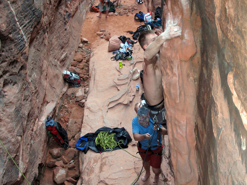 throwing the only difficult move of the climb--from the overhanging face to a big jug around the right side.  Crude Control in the Black Corridor at Red Rocks