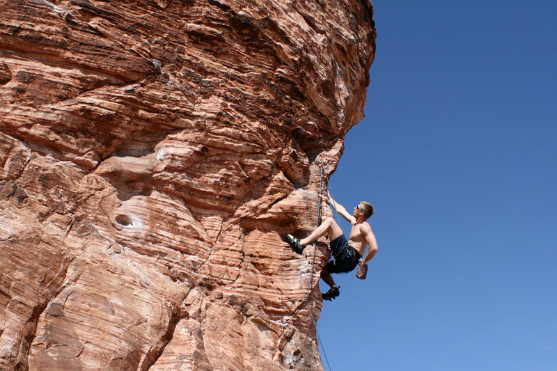 me chalking up before the crux of Caustic on the Cannibal Crag in Red Rocks