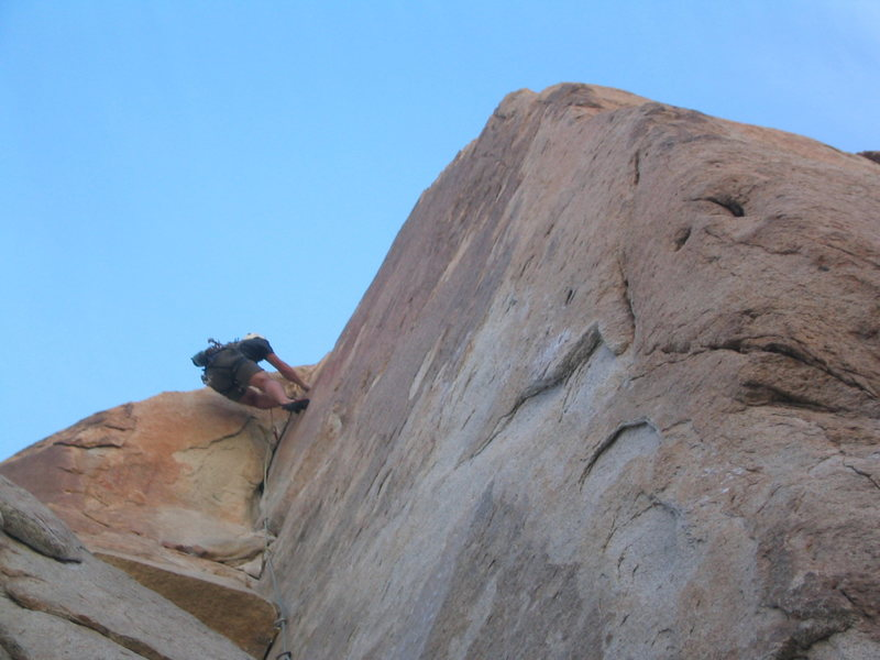 Eric on Coarse and Buggy (5.11b) at the Roadside Crags.  Super hard, thin dihedral followed by an 11a layback.  Yikes!