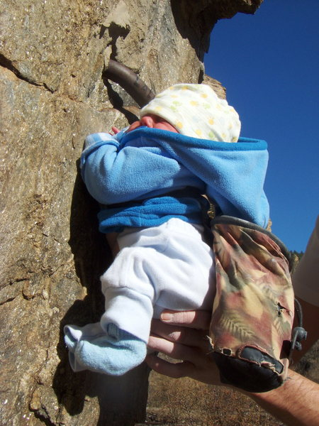 Selah Claire Schneiter, 3 days old and getting her first taste of the rock, crimping down hard on the crux moves on the west face of the Hanging Lake Boulder.