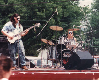 I think this was in 1990? Dayton Tenn. Strawberry fest, 12:00 noon, 98 degrees. no shade. The best we ever played.