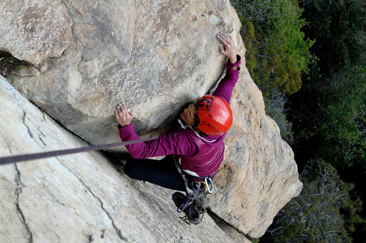 Holly prepares to tackle the crux mantle on Lieback Annie, Lower Gibraltar.