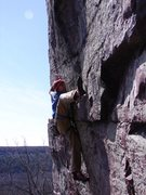Rock Climbing Photo: Dobbe into the high-step move.