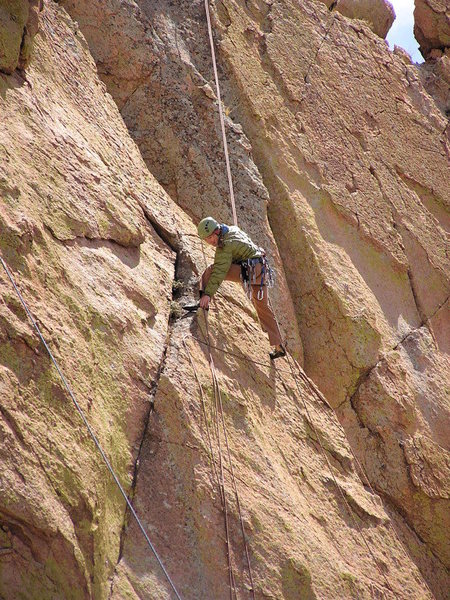 Rapping off of a route on Sheeps Head. The wind blew the rope EVERYWHERE and it caught in the chicken heads like a cat's cradle...